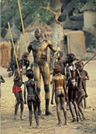 Nuba wrestler with children, photo by Riefenstahl